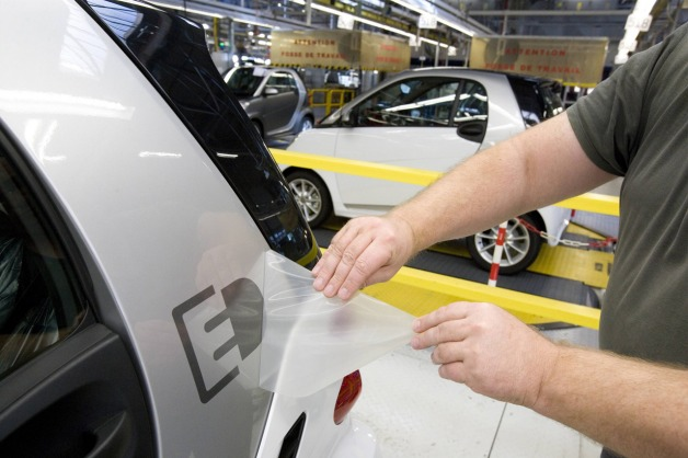 Smart ForTwo Electric Drive Logo being applied to vehicle